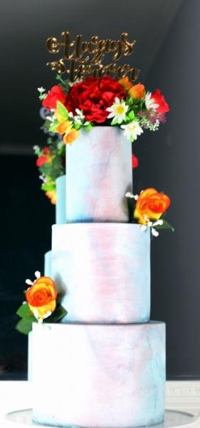 Wedding cake with silk flower topper