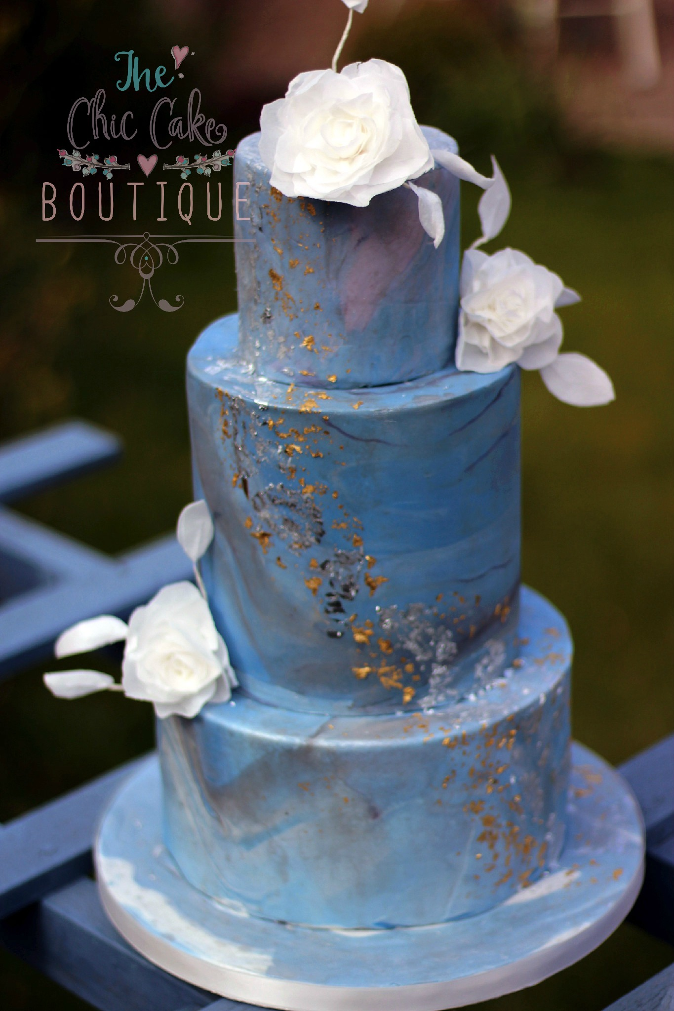 Blue marble wedding cake with glod leaf and wafer paper flowers