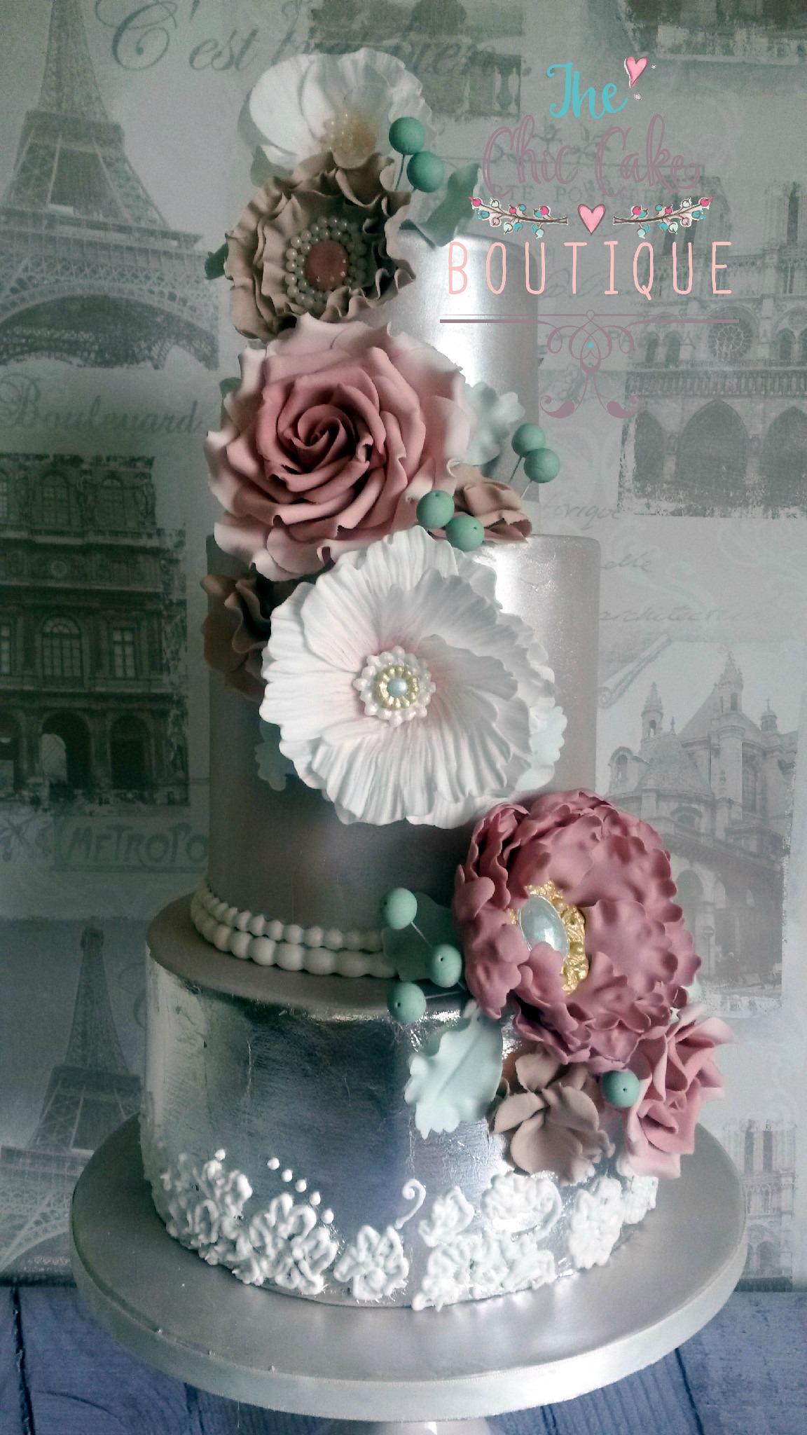 Sliver wedding cake with sugar flowers