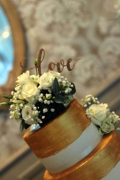 gold painted wedding cake topper