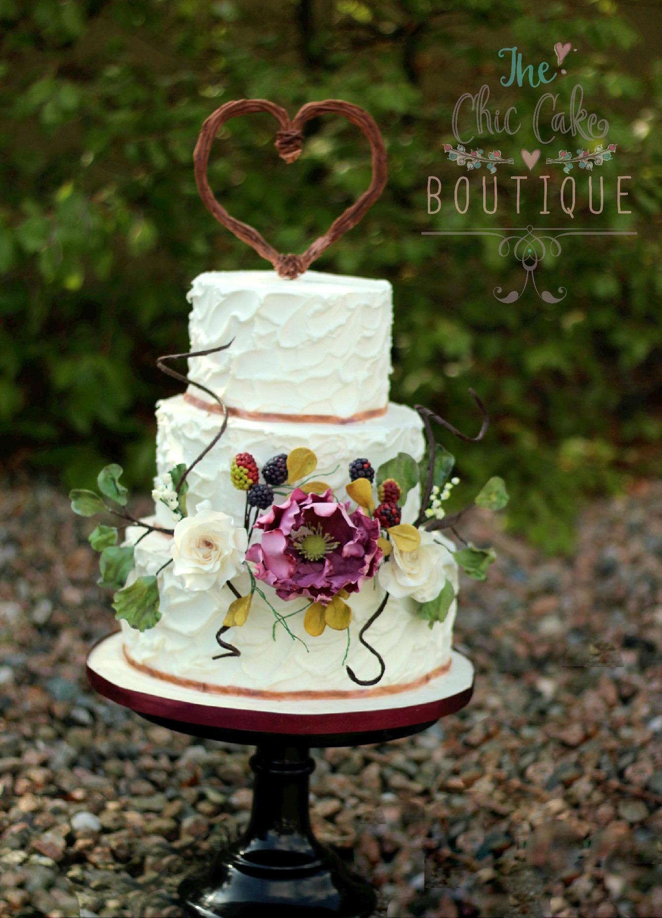 Sugar flower wedding cake with topper