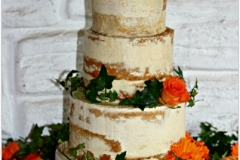 wedding cake with fresh flowers and watermark