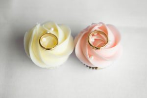 Cup cake with wedding rings