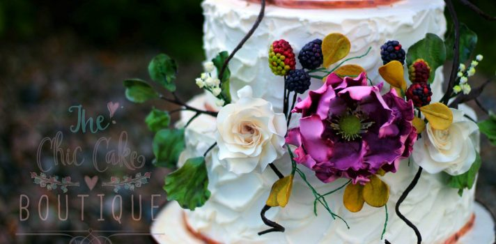 Royal icing wedding cake with homemade sugar flowers, foliage and fruit