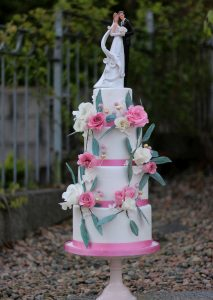 pink Wedding cake with Pink and white sugar roses