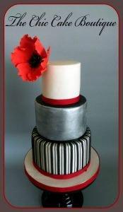 Black and silver wedding cake with sugar poppy