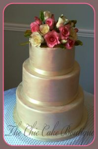 wedding cake with handmade sugar roses and leaves topper