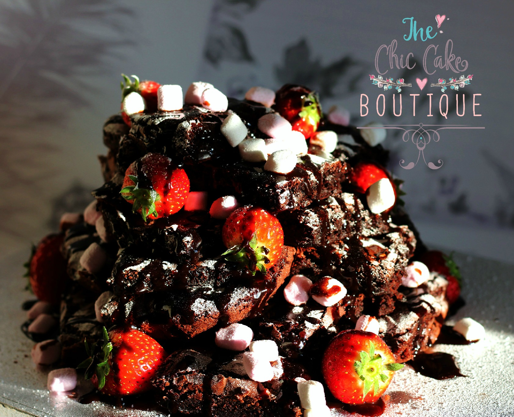 chocolate Brownie tower with marchmallow and strawberrys